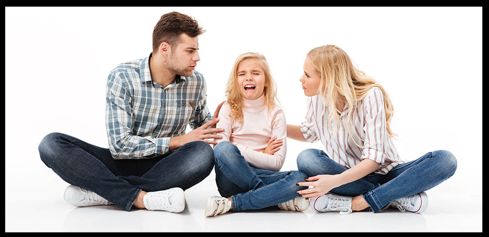 portrait-of-angry-family-sitting-together